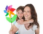 Mother and Daughter Holding Pinwheel — Stock Photo