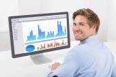 Businessman Analyzing Financial Graphs — Stock Photo