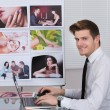 Photo Editor Using Laptop At Desk — Stock Photo #53302435