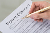 Hand Filling Rental Contract Form — Stock Photo