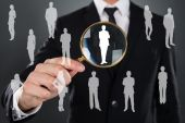Businessman Searching Candidate With Magnifier — Stock Photo