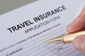 Hand Filling Travel Insurance Form — Stock Photo