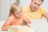 Father Helping Daughter With Homework — Stock Photo