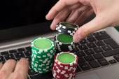 Businessman Using Laptop With Stacked Poker Chips — Stock Photo
