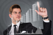 Businessman Touching Transparent Screen With Growing Bar Graph — Stock Photo