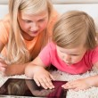 Kids Using Tablet Lying On Carpet — Zdjęcie stockowe #53932107