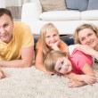Happy Young Family Laying On Carpet — Stock Photo #53932121