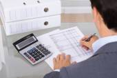 Male accountant calculating invoices — Stock Photo