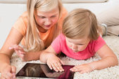Kids Using Tablet Lying On Carpet — Foto Stock