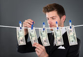 Businessman Drying Dollar Bills On Clothesline — Photo