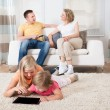 Kids Using Tablet Lying On Carpet — Zdjęcie stockowe #55140247