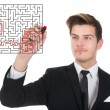 Businessman Solving Maze Puzzle On Transparent Screen — Stock Photo #55140397