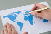 Businessman Marking Places On World Map — Stok fotoğraf