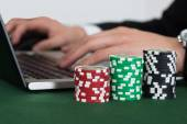 Using Laptop By Stacked Casino Chips — Stok fotoğraf