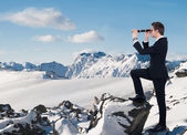 Businessman Looking Through Handheld Telescope In Snow — Stock Photo