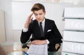 Worried Businessman Reading Document — Zdjęcie stockowe