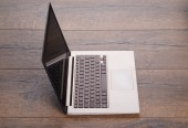 Ultrabook on table — Stockfoto