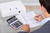 Accountant calculating finances — Foto Stock