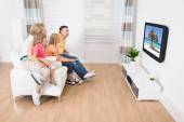 Young Family Watching TV Together — Stock Photo