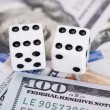 Dices on dollar currency — Stock Photo #55976439