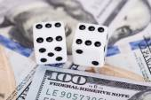 Dices on dollar currency — Stock Photo