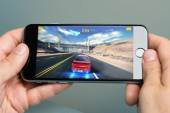 Hands Playing Asphalt 8 Game On Apple iPhone 6 — Stock Photo