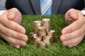 Businessman Protecting   Coins — Stock Photo