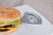 Burger On Weighing Scale — Stock Photo