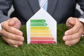 Businessman Protecting Energy — Stock Photo