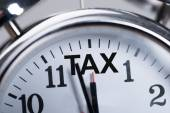 Alarmclock Showing Arrival Of Tax — Stock Photo