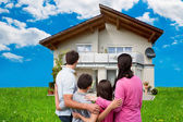Family Looking At  House — Stock Photo