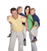 Parents Piggybacking Children — Stock Photo