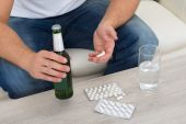 Man With Bottle And Pills In Hand — Stock Photo