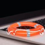 Orange Buoy On Laptop — Stock Photo #62702763
