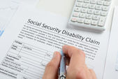 Filling Social Security Disability Form — Stock Photo