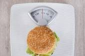 Burger On Weight Scale — Stock Photo
