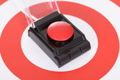 Red Button Over Dartboard — Stock Photo