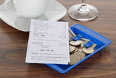 Bill And Currency On Table — Stock Photo
