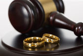 Wedding Rings And Wooden Gavel — Stock Photo