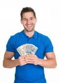 Man Holding Us Paper Currency — Stock Photo