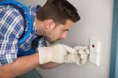 Man Repairing Light Switch At Home — Photo