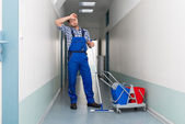 Male Worker Cleaning Office Corridor — Stock Photo