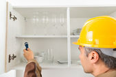 Pest Control Worker Checking Shelf — Stock Photo