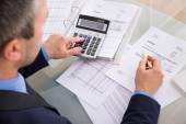Businessman Doing Calculating — Stock Photo