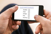 Person Filling Customer Survey Form — Stock Photo