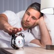 Man Snoozing Alarm Clock — Stock Photo #62721171