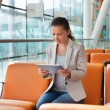 Businesswoman With Digital Tablet At Airport — Stock Photo #62723337