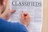 Man Looking In Classifieds For Job — Stock Photo