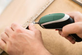 Person Drilling Furniture — Стоковое фото