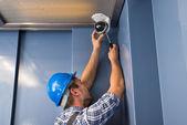 Cctv Technician Fixing Camera — Stock Photo